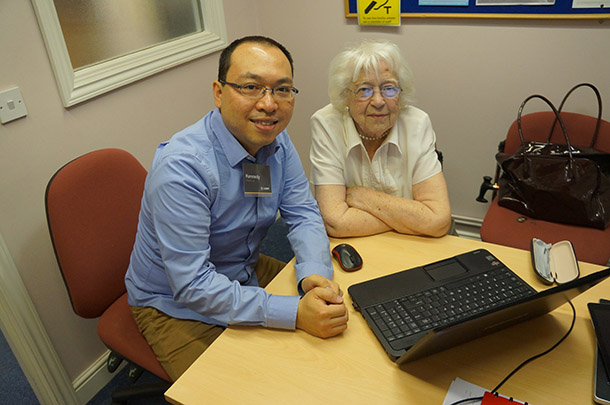Tutor and founder of Lxpert, Kennedy Cheng helps a customer at Age UK Suffolk